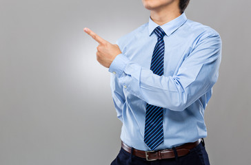Businessman with two finger point aside