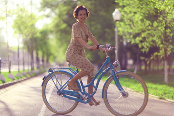 girl in a dress on a bicycle