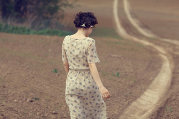 girl on the road in a field