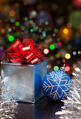 Christmas gift set with colorful bokeh background