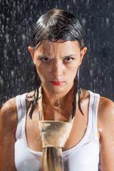 Brunette woman under rain