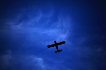 Retro-biplane aircraft, against the blue sky