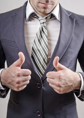 Thumbs up: Businessman closeup image