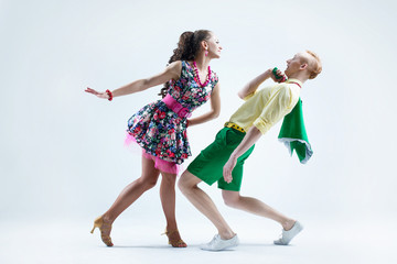 Funny dancer couple dressed in boogie-woogie  pin up  style