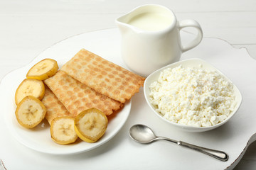 Delicious breakfast with milk, cookies and cottage cheese