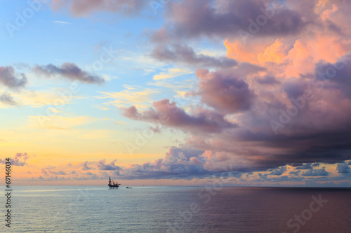 Wall mural Offshore jack up drilling rig in the middle of the ocean during