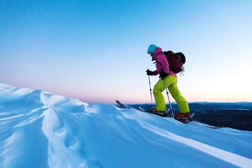 Skier go up mountain