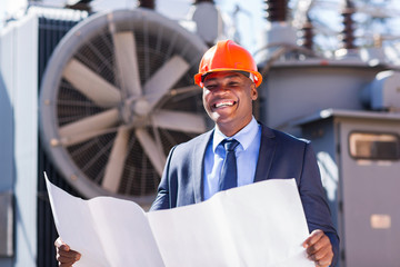 young african electrical manager holding blueprint