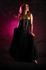 redhead woman in black dress