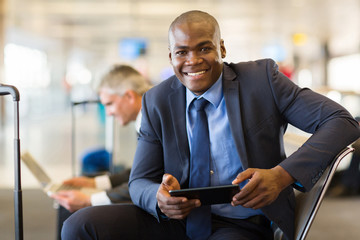 african business traveler using tablet computer