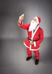 Santa Claus made a selfie with phone