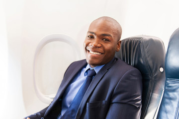 african american airplane passenger relaxing on plane