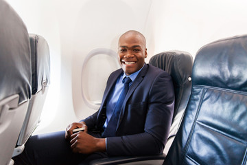 afro american businessman on board of an airplane