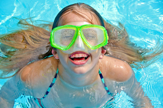 young girl with swim goggles