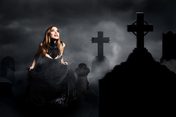 sexy vampire on a graveyard