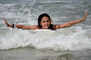 Little Girl Body Surfing