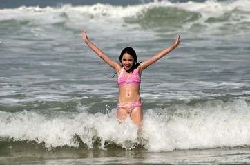 Little Girl Having Fun on the Beach