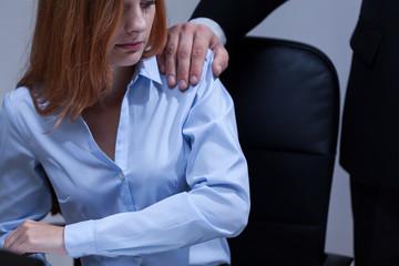 Woman feeling uncomfortable at work