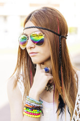 Portrait of young beautiful woman with sunglasses hippie style.