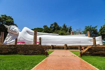 big white reclining buddha statue in thai temple