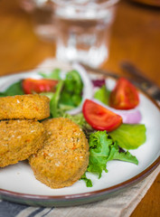 Chicken nuggets with salad