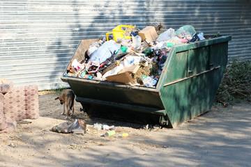 Overfilled trash dumpster in ghetto neigborhood in Russia
