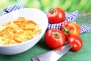 Casserole with vegetables in bowl  on natural background