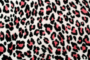 Red black leopard pattern.Spotted fur animal print as background