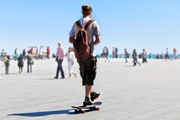Skateboarding on the beach.