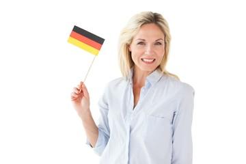 Smiling blonde woman holding german flag