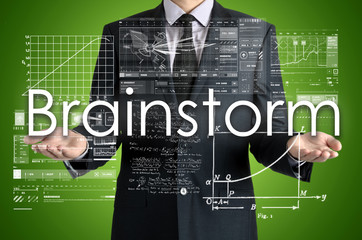 the businessman is presenting the business text with the hand: Brainstorm