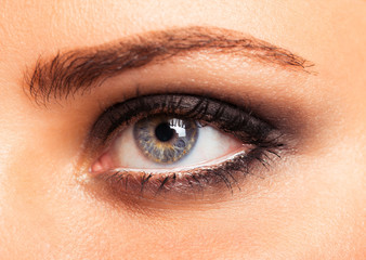 Closeup of beautiful womanish eye with glamorous makeup
