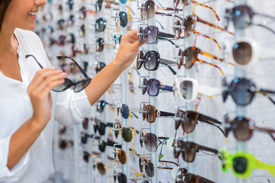 Choosing sunglasses in store.