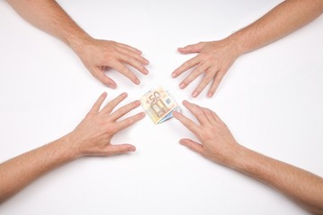 hands fighting for a wad of euros