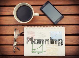 Notebook with text Planning inside on table with coffee