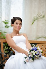 Portrait of beautiful bride with a bunch of flowers