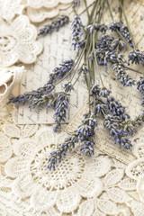 dried lavender flowers and vintage love postcards
