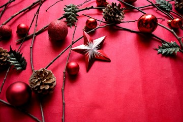 Red Christmas ornament balls with star on red background