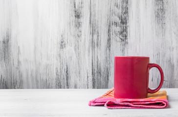 Still life red mug kitchen cloth