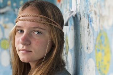 Portrait of young cute girl hippie, outdoors