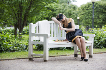 Woman  with mask take rest on bench