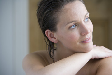 Bare chested woman with wet hair, close-up