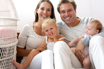 Happy family smiling with baby