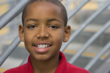 Boy (9-11) smiling, portrait, close-up