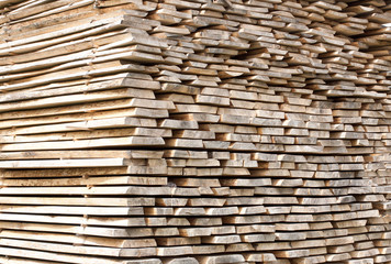 Stack of wood planks for construction buildings and furniture