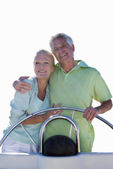 senior couple standing together on boat, cut out