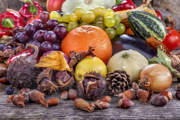 Autumn fruits, nuts and vegetables on the table