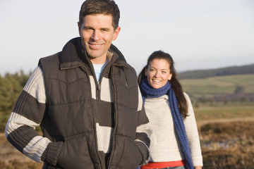 Smiling couple in countryside