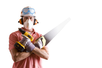 Construction worker in protective gear with saw and drill