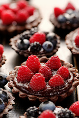 Delicious tartlets with chocolate and fresh berries